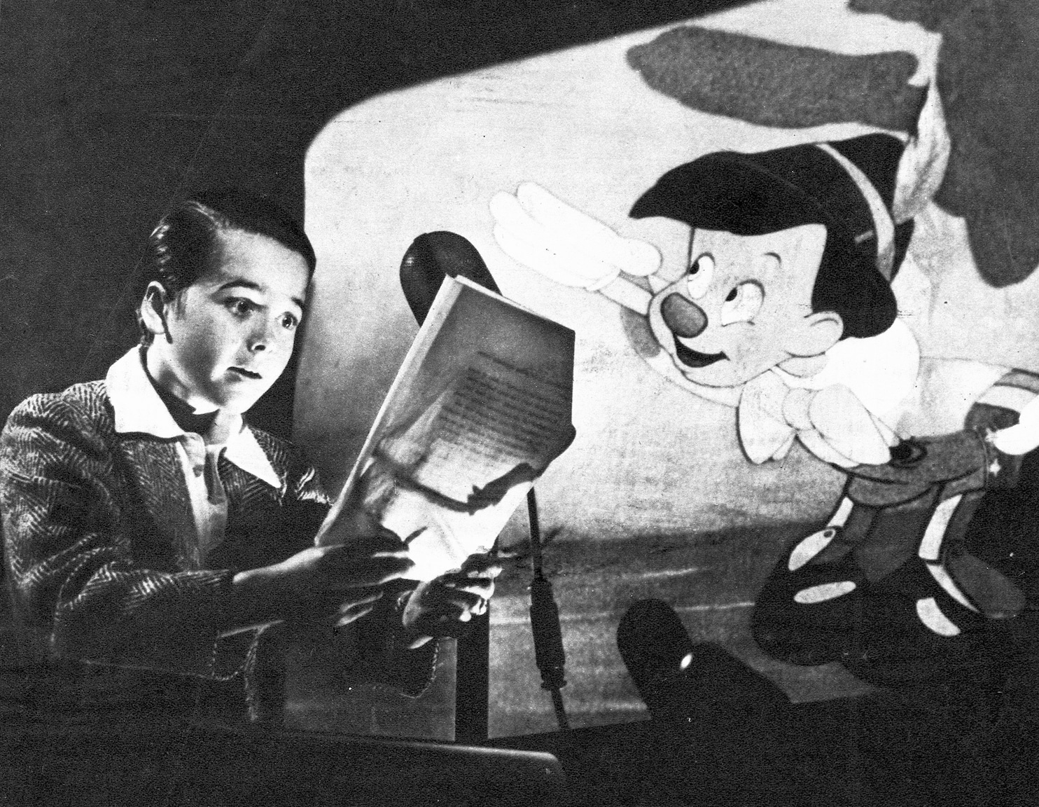 Little Dickie Jones first sees a drawing that Walt made just for him.