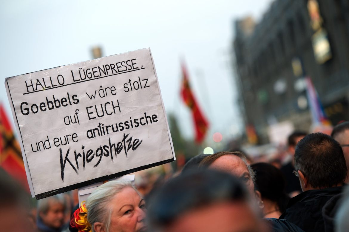 German sign held up in a crowd