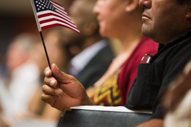 holds an american flag during at the atlanta office of the us citizenship and immigration services in 2016 kevin d lilesfor the washington post