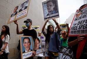 Hundreds of people marched to the U.S. consulate in Hong Kong on Saturday in support of Edward Snowden, an American citizen who leaked top-secret information about U.S. surveillance programs.