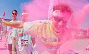 epa03779183 Participants in the Color Run have pink powder thrown at them in Hanover, Germany, 07 July 2013. Several thousand participants took part in a 5 km run durign which they had colorful powders thrown at them. EPA/JULIAN STRATENSCHULTE