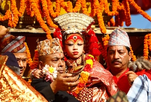 Living Goddess Kumari is carried to be worshipped on her chariot during the Indra Jatra festival in Kathmandu September 18, 2013. The annual festival, named after Indra, the god of rain and heaven, is celebrated by worshipping, rejoicing, singing, dancing and feasting in Kathmandu Valley to mark the end of monsoon season. Indra, the living goddess Kumari and other deities are worshipped during the festival. REUTERS/Navesh Chitrakar (NEPAL - Tags: RELIGION SOCIETY)