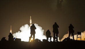 Photographer take pictures as the Soyuz TMA-10M spacecraft carrying the International Space Station (ISS) crew of U.S. astronaut U.S. astronaut Michael Hopkins, Russian cosmonauts Oleg Kotov and Sergey Ryazanskiy blasts off from the launch pad at the Baikonur cosmodrome September 26, 2013. REUTERS/Shamil Zhumatov  (KAZAKHSTAN - Tags: SCIENCE TECHNOLOGY)