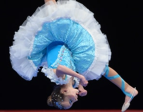 Young dancer Sandra Rothova from Slovakia competes in the preliminaries of the World Show Dance Championships in Riesa, Germany, Monday, Nov.25, 2013. Some 3,000 dancers from 31 countries will compete for the world champion titles in show dance and tap dance.  (AP Photo/Hendrik Schmidt/dpa)