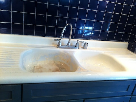 reglaze kitchen sink microwave cabinet how to replace enamel on a cast iron the washington post reader s enameled is showing some wear and tear photo