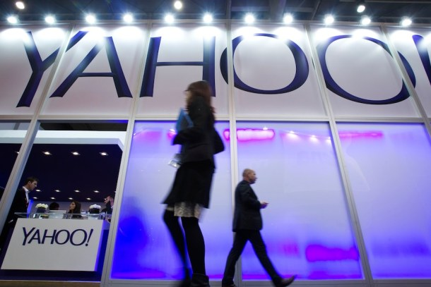 Pedestrians pass the Yahoo Inc. pavilion on day two of the Mobile World Congress in Barcelona, Spain, on Tuesday, Feb. 25, 2014. Top telecommunication managers will rub shoulders in Barcelona this week at the Mobile World Congress, Monday, Feb. 24 - 27, a traditional venue for showcasing the latest products for dealmaking. Photographer: Angel Navarette/Bloomberg