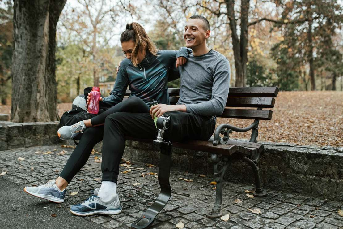 photo of couple exercise resting park