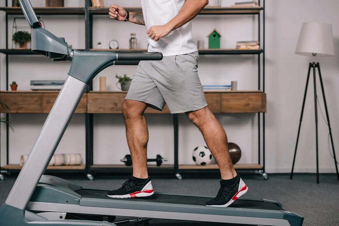 photo of man running on treadmill