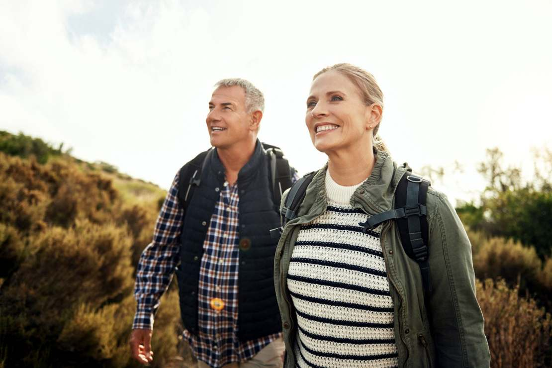 photo of mature couple hiking
