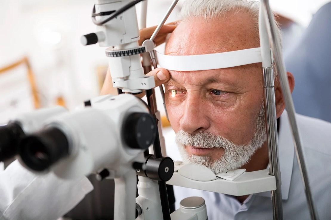 senior man receiving eye exam