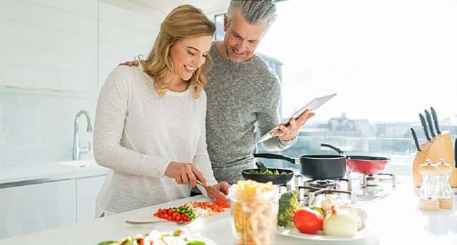mature couple preparing meal