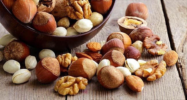 mixed nuts on wooden table