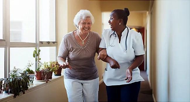 caregiver and senior laughing