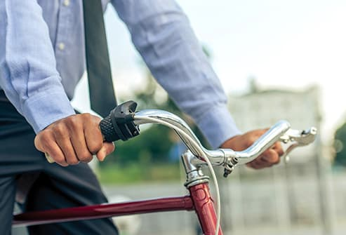 businessman on bicycle close up