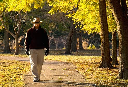 mature man walking alone in park