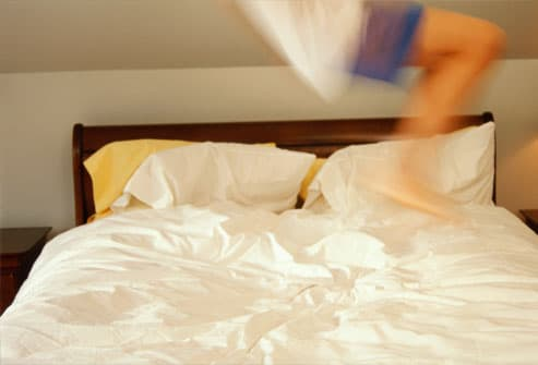 child jumping on bed, blurred motion