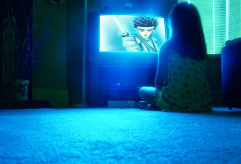 girl watching anime cartoon on television