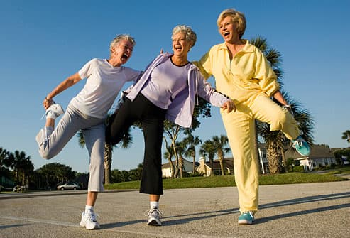 Group of mature women stretching