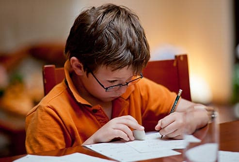getty_rf_photo_of_boy_writing