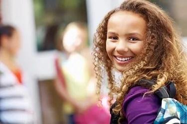 getty_rf_photo_of_smiling_schoolgirl