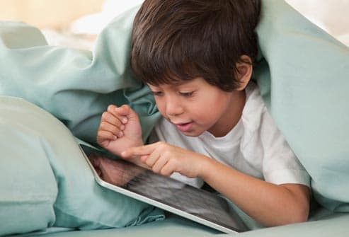 getty_rf_photo_of_child_using_tablet