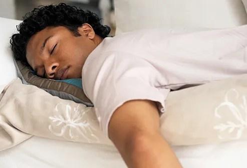 man sleeping on stomach