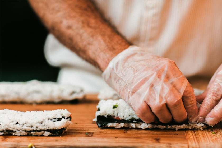 chef pressing rice into sushi