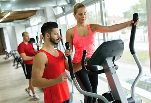 woman using elliptical trainer