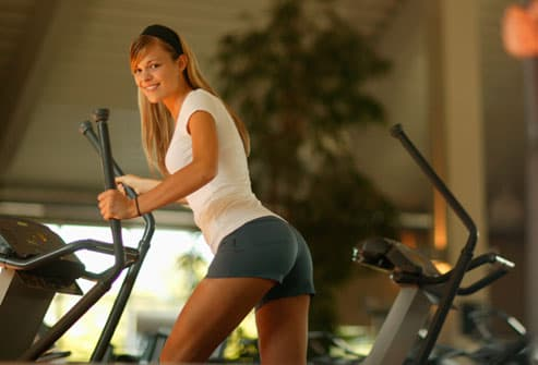 Woman Strength Training in Gym