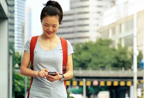 woman on phone taking walk