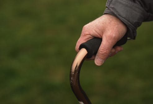 close up of man holding cane