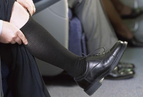 man wearing flight socks on plane