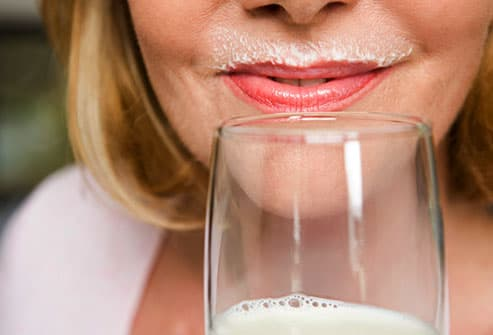 Close up of mature woman with milk mustache