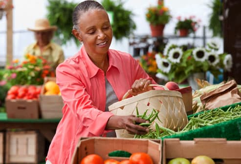 Mature woman shopping farmers market - Eating for a Long Life