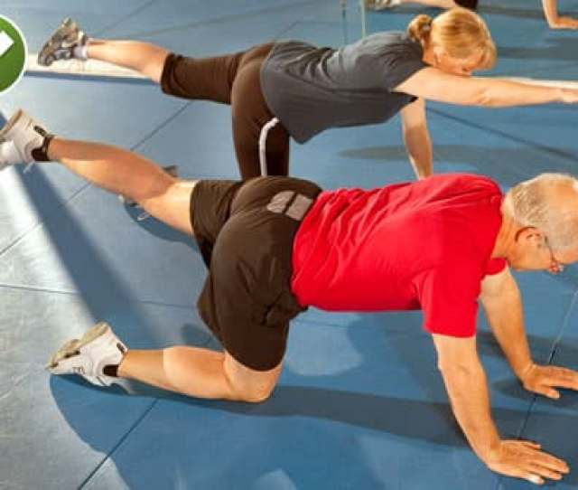 Couple Doing Bird Dog Stretch