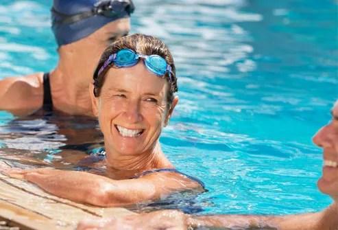 Woman swimming with fibromyalgia