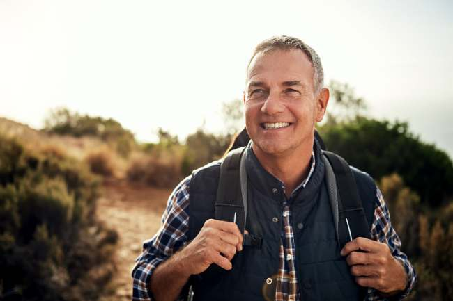 photo of mature man hiking