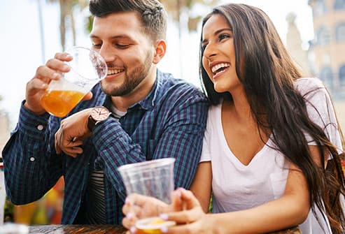 couple in cafe drinking beer