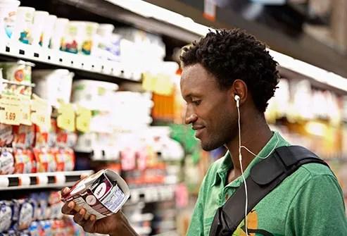 man reading yogurt label