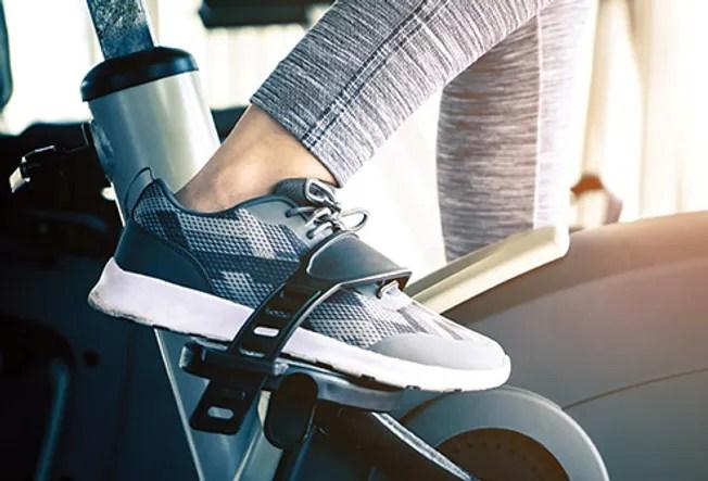 shoe on exercise bike close up