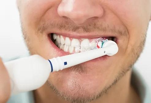 using electric toothbrush