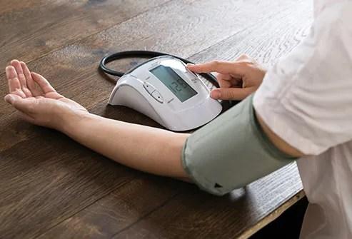 woman measuring blood pressure