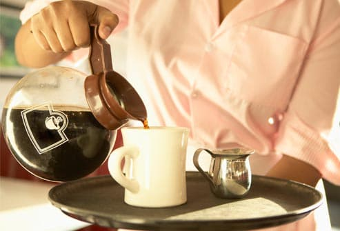 waitress pouring cup of coffee