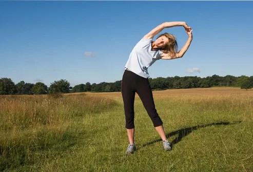 Woman Runner Stretching