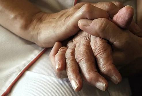 comforting hands alzheimers patient