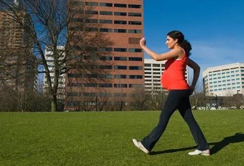 pregnant woman power walking
