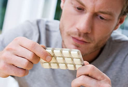 Man holding packet of nicotine gum