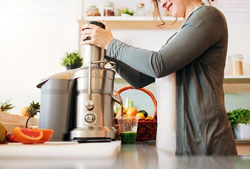woman using juicer