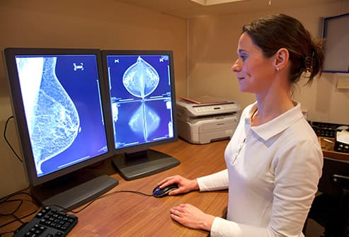 woman looking at breast scan