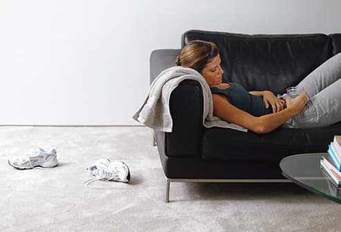 woman on couch after workout